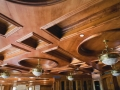 Wood custom ceiling with bronze alabaster light fixtures